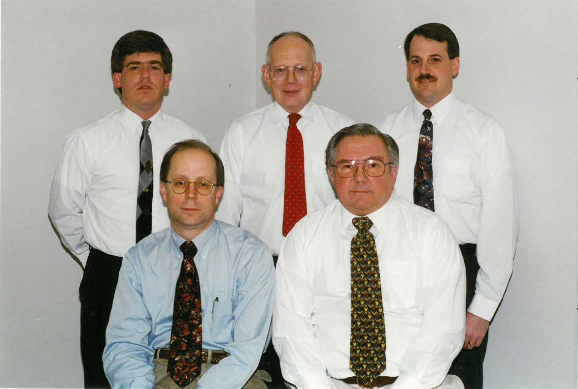 Front Row (left-right): Scott Rudie and Dennis Nelson. Back Row (left-right): Joseph Pearce, Andrew Erdmann and Michael Woehrle