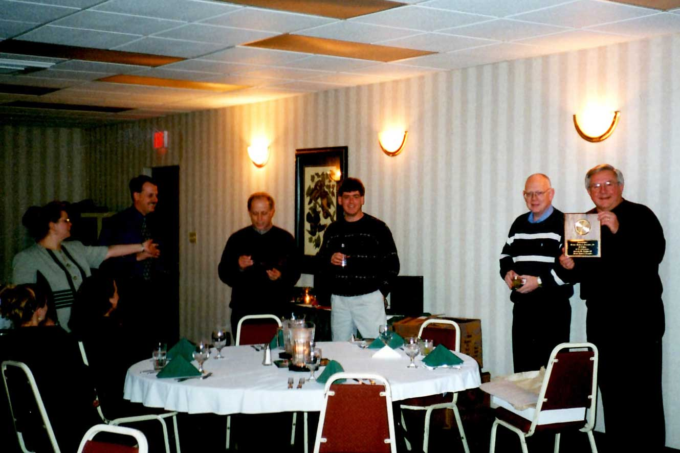 2000 Holiday Party; Recognizing Dennis Nelson for 25 years with Nelson-Rudie.
